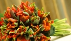 Coral hand tied flower arrangement bouquet by Kate Mell Flowers