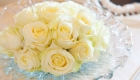 White avalanche roses in a beautiful vintage glass bowl