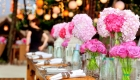 Wedding top table pink hydrangea flowers with candle and mercury glass centrepieces