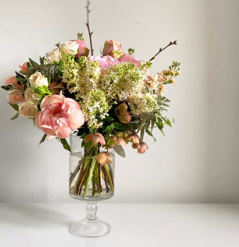 Rose & Apricot Hand Tied Bouquet in a glass vase
