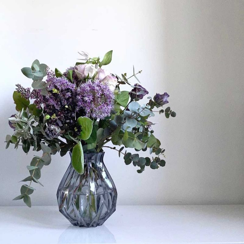 Violet & Lilac Hand Tied Bouquet in a glass vase